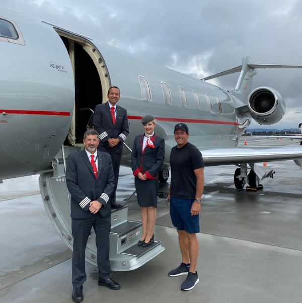 HIGH FLYER: Big Phil and his private airline staff.